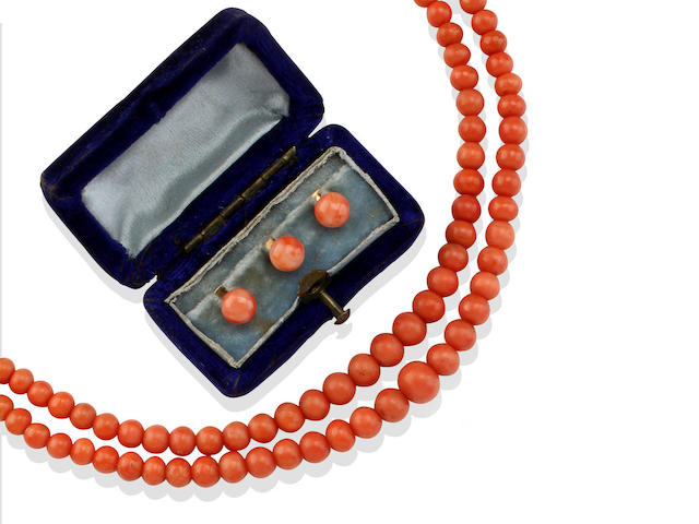 A late 19th century coral necklace and three studs (2)