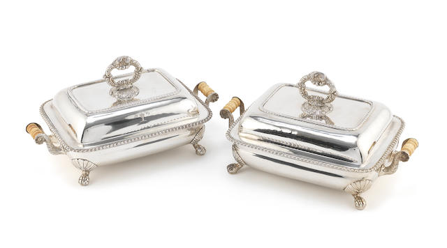 An impressive pair of early 19th century two-handled Indian Colonial silver warming dishes and stands, with plated covers and handles by Cropley & Co, Calcutta 1819-25 (2)