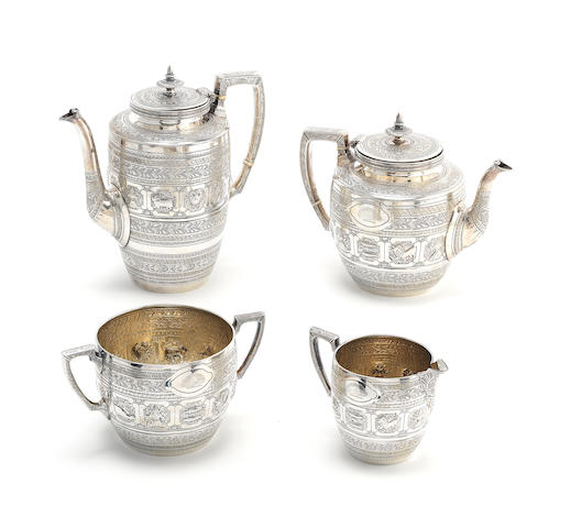 A Victorian Zodiac-pattern silver four-piece tea service by Gibson & Langman, Sheffield 1885, also with incuse mark for Goldsmith & Silversmith Company London