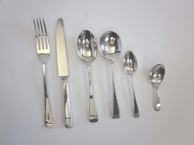 A silver Old English Feather Edge pattern table service of flatware predominately with varying maker's marks for James W Potter & Sons, London 1984 - 1993, all pieces with additional stamp of a roundel, centred with an emblem