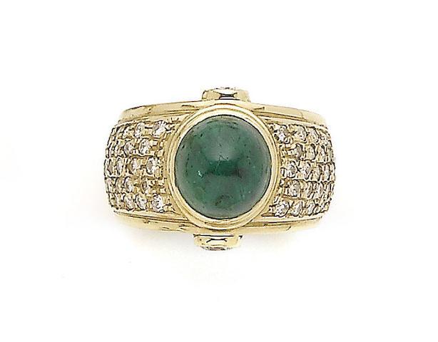 An emerald and diamond dress ring