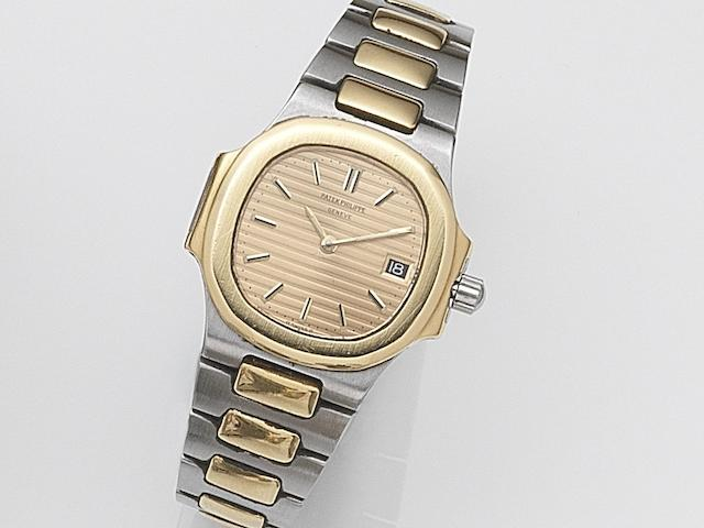Patek Philippe. A lady's stainless steel and gold quartz calendar bracelet watch  Nautilus, Ref:4700/1, Case No.557854, Movement No.1523961, Circa 1985