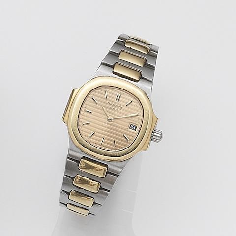 Patek Philippe. A lady's stainless steel and gold quartz calendar bracelet watch  Nautilus, Ref:4700/1, Case No.557854, Movement No.1523961, Circa 1985