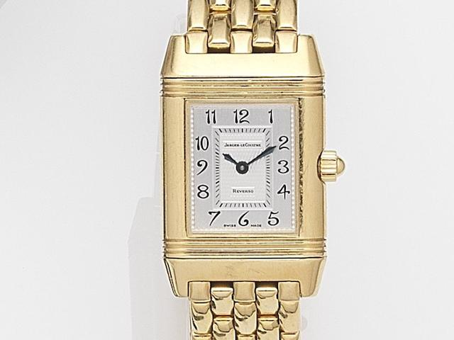 Jaeger-LeCoultre. A lady's 18ct gold dual sided manual wind reversible bracelet watch Reverso Duetto, Case No.1945194, Circa 2001