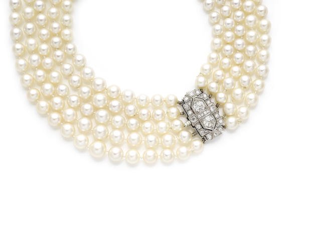A multi-strand cultured pearl necklace with diamond clasp