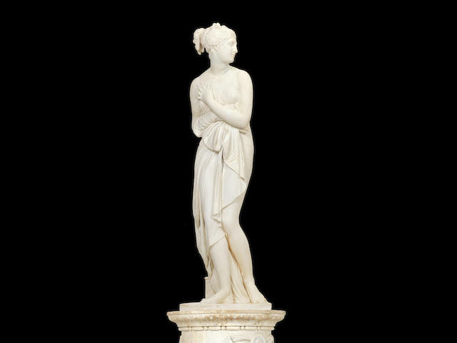 After Antonio Canova, Italian (1757-1822): An impressive 19th century carved white marble figure of Venus Italica on cylindrical plinth