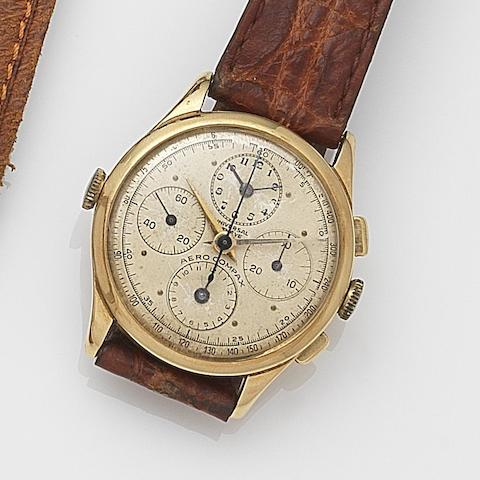 Universal. An 18ct gold manual wind chronograph wristwatch with dual time zones Aero Compax, Ref:22477, Case No.877801, Movement No.234971, Circa 1940