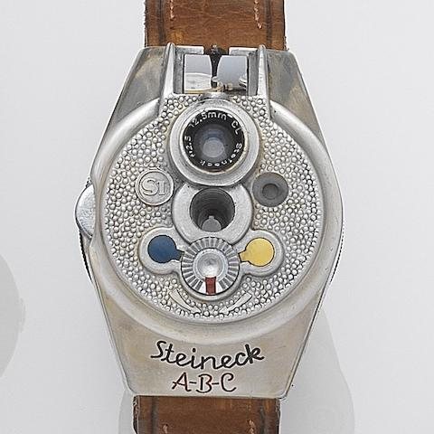Steineck ABC. A rare stainless steel camera watch Circa 1949