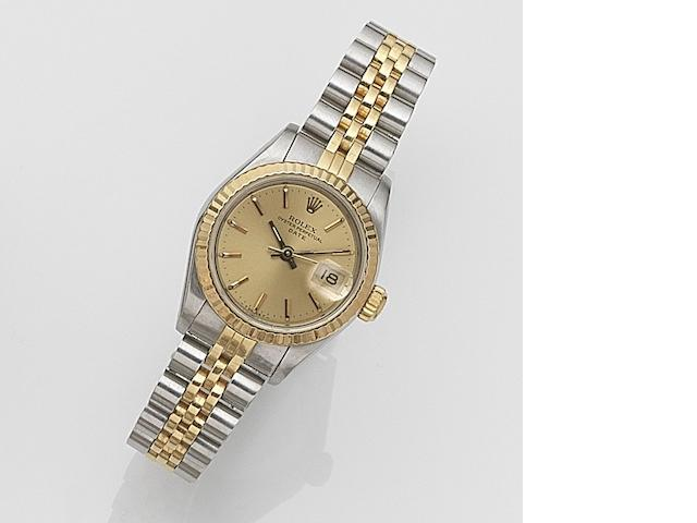 Rolex. A lady's stainless steel and gold automatic calendar bracelet watch  Date, Ref:69173, Serial No.817****, Movement No.090***, Sold 5th July 1984