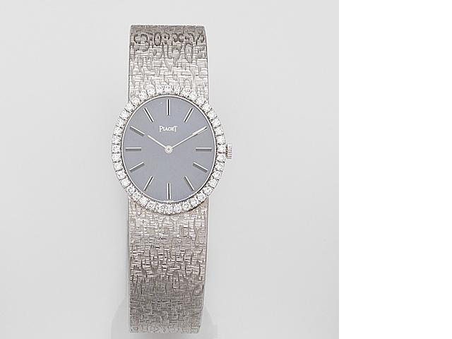 Piaget. A lady's 18ct white gold and diamond set manual wind bracelet watch  Ref:9826A68, Case No.294142, Movement No.7791355, Circa 1970