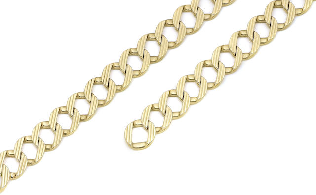 A pair of gold bracelets, by Cartier (2)