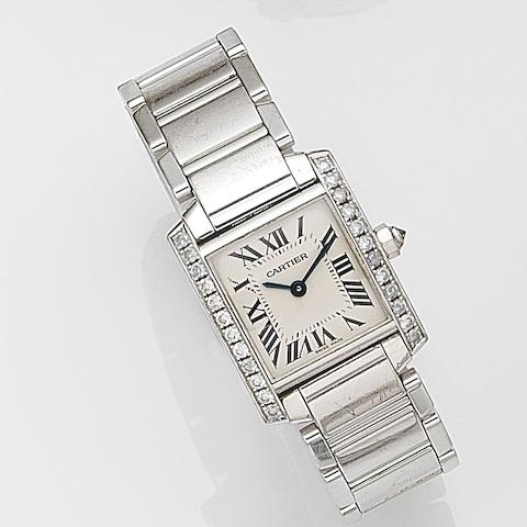 Cartier. A lady's 18ct white gold and diamond set quartz bracelet watch  Tank Française, Ref:2403, Case No.882844CD, Sold 14th August 2003
