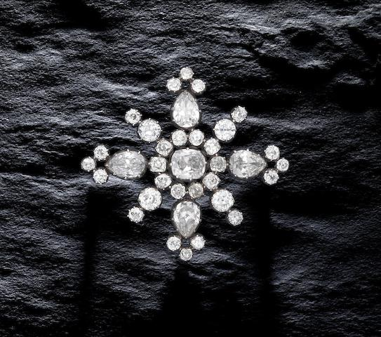A diamond cross brooch,