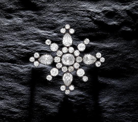 A diamond cross brooch,