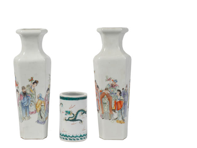 A pair of famille rose vases Qianlong four-character marks, 20th century, of tapered hexagonal form, painted the full way round with various figures on a white ground, 29cm high, together with a dragon decorated Bitong with Chenghua mark (3)