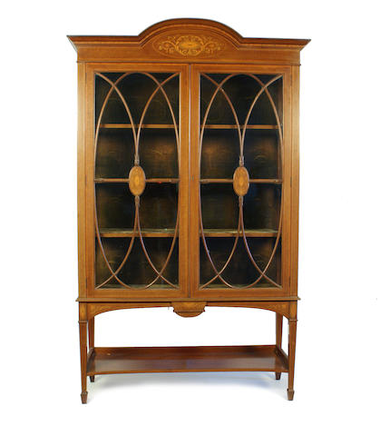 A good Edwardian mahogany and inlaid floor standing display cabinet