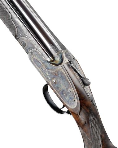 A fine Tallet-engraved 20-bore (2¾in) single-trigger over-and-under sidelock ejector gun by C. Hellis & Sons, no. 6020 In a leatherette case
