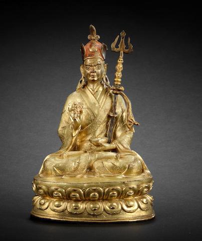 A gilt-bronze figure of Padmasambhava 16th century