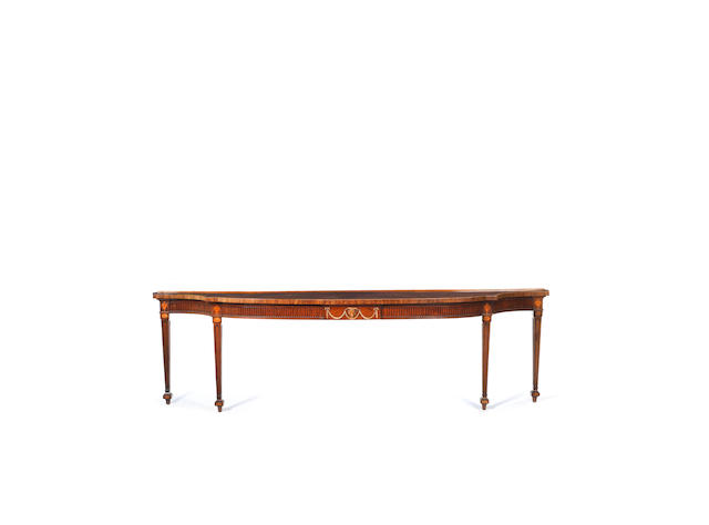 A narrow George III mahogany and boxwood banded serpentine serving table in the manner Thomas Chippendale