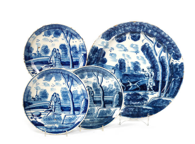 An 18th century Delft charger and a set of three similar period Delft plates the charger possibly Lambeth
