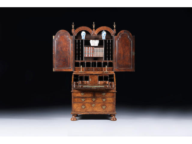 A Queen Anne walnut and featherbanded double domed bureau bookcase