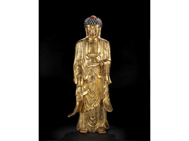 A very rare monumental gilt-lacquer porcelain figure of Buddha Qing dynasty