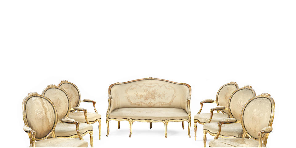 A set of six George III carved and giltwood open armchairs, together with a similar settee  in the manner of John Linnell