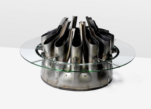 Rosario Gallina and Tiziano Rutilo for Relicta Design Mixer Tulip 737 Tabledesigned and executed in 2011salvaged aluminium aircraft turbine and glassHeight: 75cm.29 1/2 in.Diam.: 122cm.48 1/16 in.