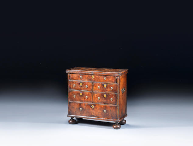 A George I walnut and featherbanded bachelor's chest