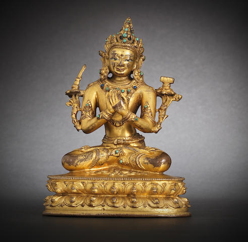 A gilt-bronze figure of Manjusri 15th century