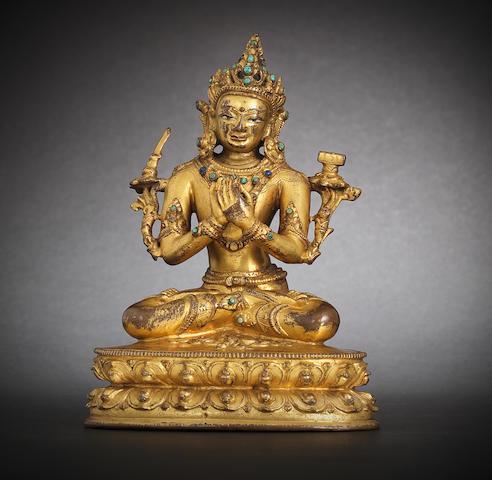 A gilt-bronze figure of Manjusri 15th century