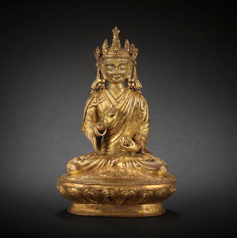 A gilt-bronze figure of Guru Padmasambhava 16th century