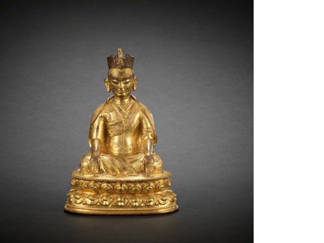 A gilt-bronze figure of Karmapa 16th century