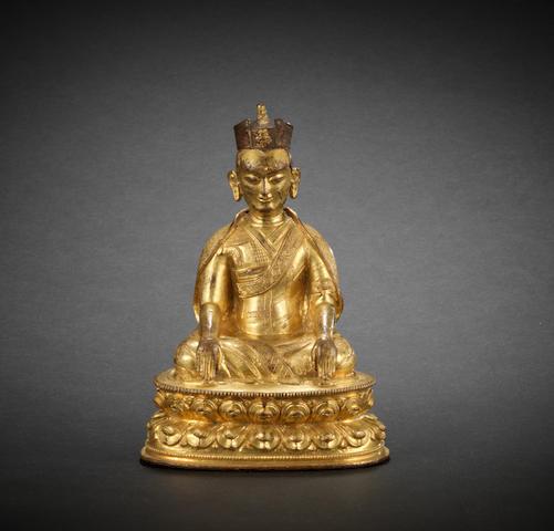 A gilt-bronze figure of Karmapa 16th century