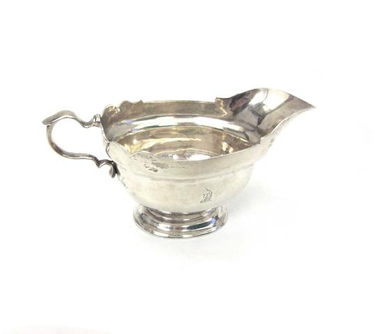 A George III silver sauce boat by Francis Crump, London 1768 and four further items(5)