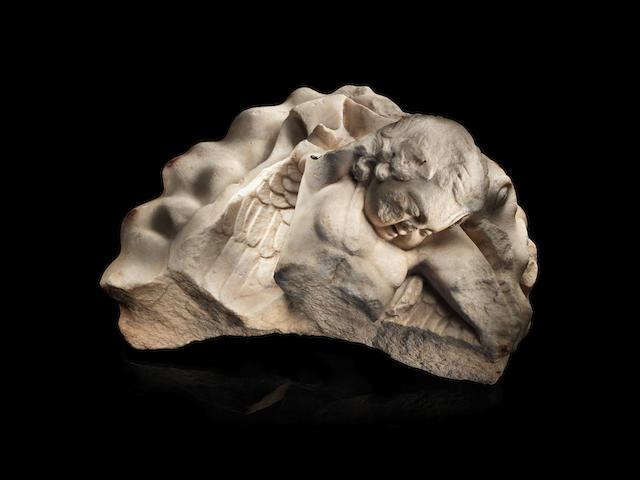 A Roman marble fragment of a sleeping Eros