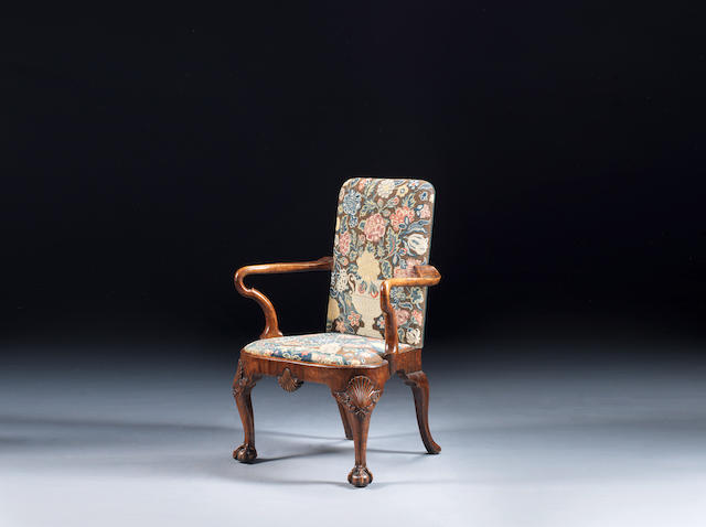 A George I walnut armchair upholstered in the original 18th century petit point needlework