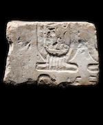 An Egyptian limestone double-sided relief fragment for Nefertiti