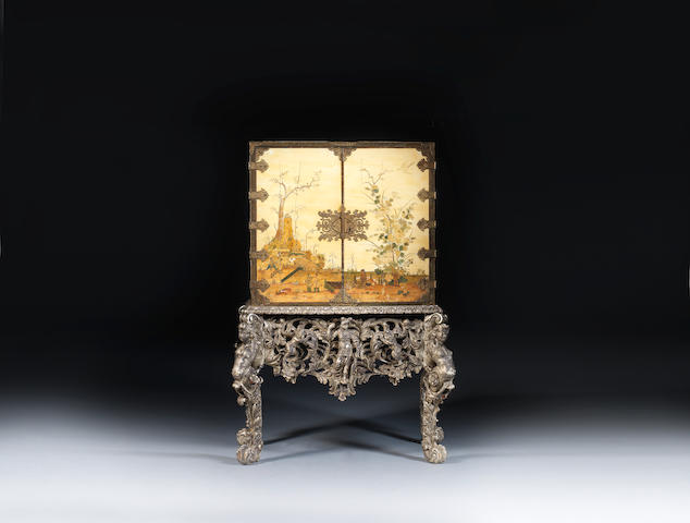 A Charles II white japanned cabinet on carved silvered stand