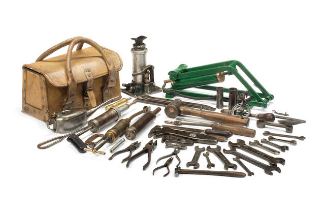 A vintage Bentley owner drivers' toolkit in leather toolbag,