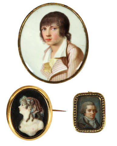 French School, circa 1790 A portrait miniature of a Young Boy, wearing pink and white pin striped coat over yellow waistcoat and white chemise