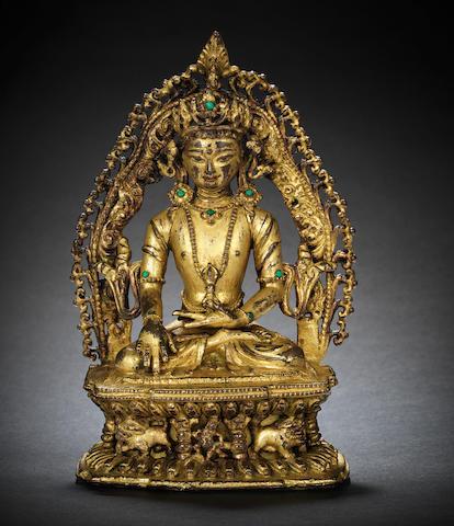 A gilt-bronze figure of Aksobhya 15th century