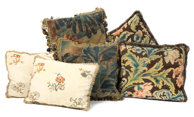 A group of six tapestry and embroidered cushions