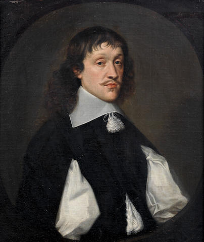 French School, 17th Century Portrait of a gentleman, half-length, in a black coat and white lawn collar, in an English 18th century carved frame