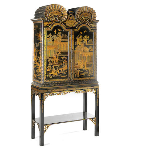 An early 19th century Chinese black and gilt chinoiserie decorated Export cabinet on a later stand