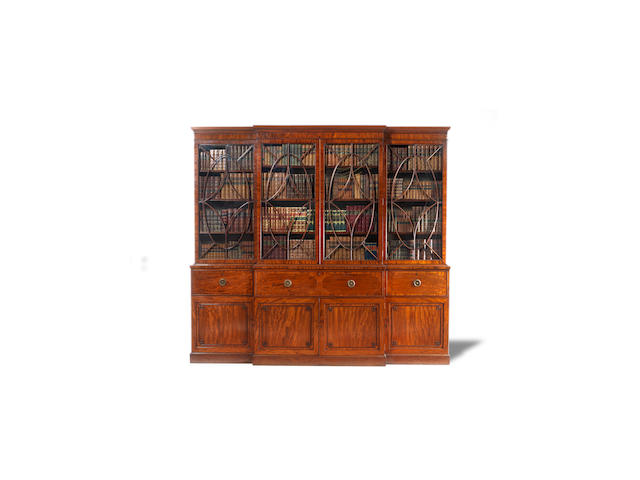 A George III mahogany and crossbanded breakfront secretaire library bookcase