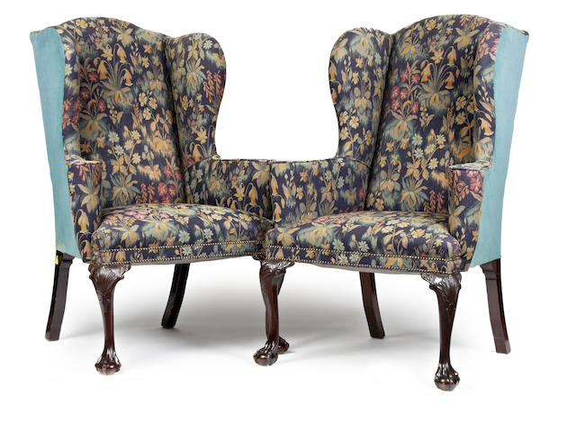 A pair of mahogany high wing back armchairs
