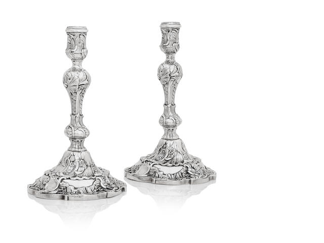 A pair of George II silver candlesticks by Elizabeth Godfrey, London 1742