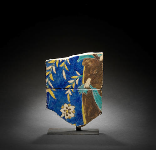 Two Safavid cuerda seca pottery Tile Fragments depicting a strolling courtier Persia, 17th Century