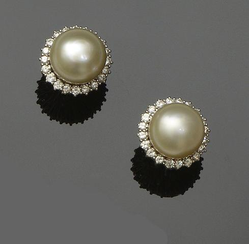 A pair of cultured pearl and diamond earclips